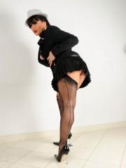 Smoking lady Amanda in black dress high heels and stockings